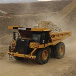 Dump truck gets stuck on route to mine