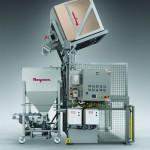 Sanitary high lift box tipper with vibratory bin feeder